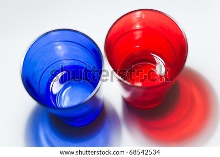 blue and red glasses with water