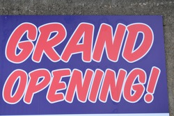 Blue and red grand opening sign