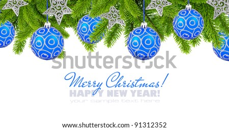 Blue and silver christmas decoration baubles and pine on white background with space for text