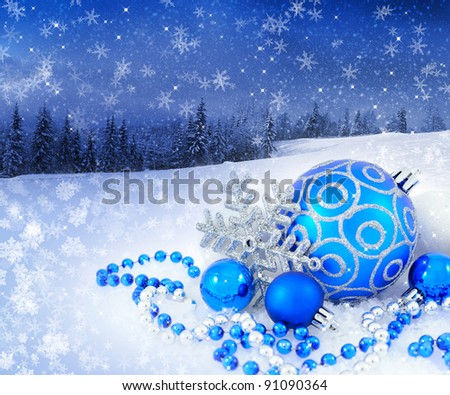 Blue and silver christmas decoration baubles on a background a winter landscape