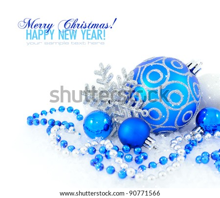 Blue and silver christmas decoration baubles on white with space for text