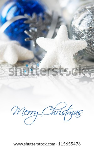 Blue and silver xmas baubles on holiday background with copy space
