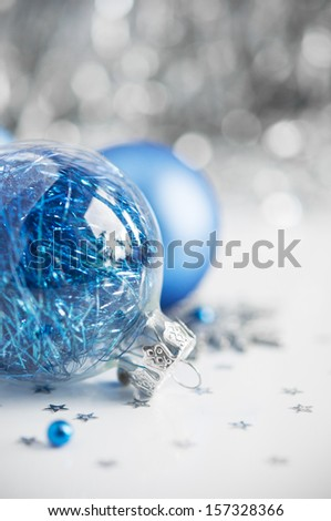 and silver xmas ornaments on bright holiday background with space