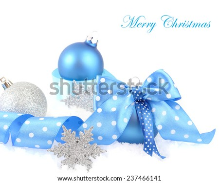 Blue and silvery Christmas balls on a white background.