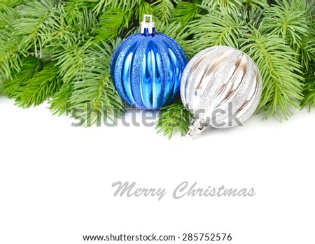 Blue and silvery Christmas balls on branches of a Christmas tree on a white background. A Christmas background with a place for the text.