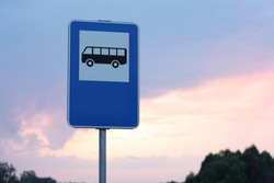 Blue and white bus stop sign in Europe with sky background