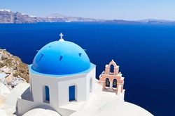Blue and white church of Oia village on Santorini island. Greece