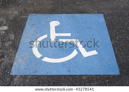 Blue and White Handicap Symbol Painted on a Road