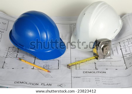 blue and white hard hats on blue prints