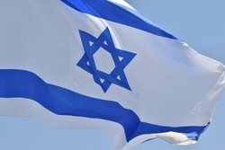 Blue and white Israeli flag with a Star of David in the middle, the flag of the State of Israel