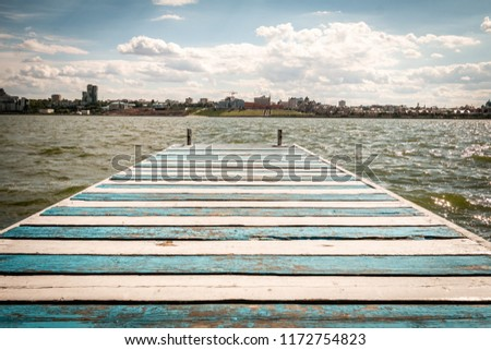Blue and white lines pier with the cloudy sky #1172754823