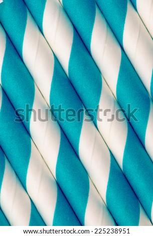 Blue and white paper straw closeup background vintage