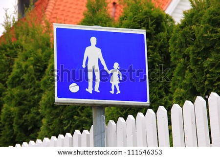 Blue and white parent and child road safety sign