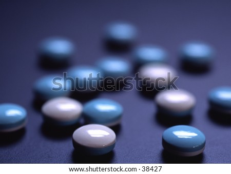 Blue and white pills.
