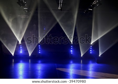 Blue and white spotlights on a stage