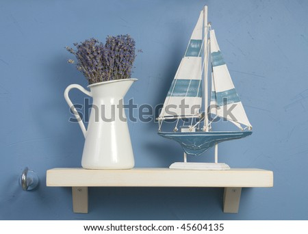 Blue and white still-life with lavender and sailboat
