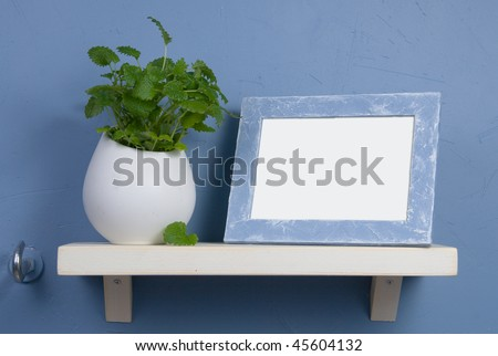 Blue and white still-life with round vase and frame