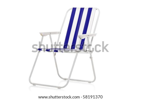 Blue and white striped beach chair isolated on white background