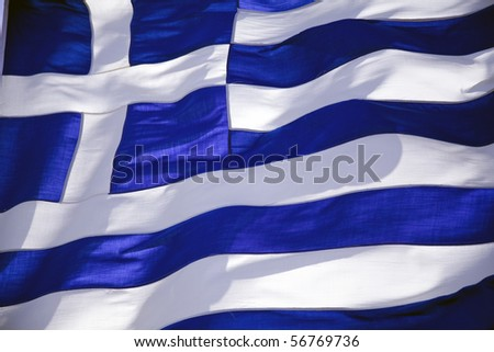 Blue and white the greek flag in the wind - stock photo