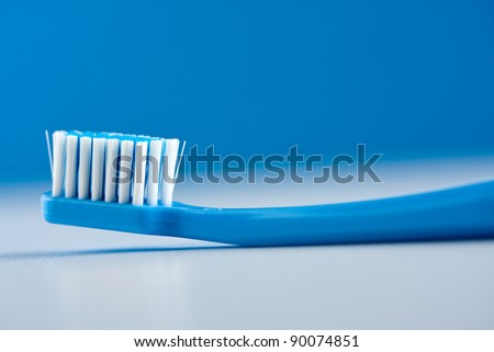 Blue and white toothbrush, close up