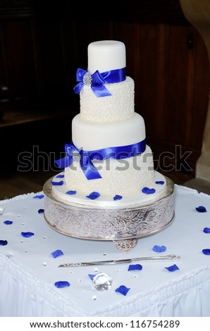 Blue and white wedding cake at reception
