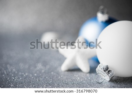 Blue and white xmas ornaments on glitter holiday background. Merry christmas card. Winter holidays. Xmas theme.