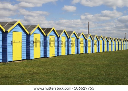 Blue and Yellow painted beach huts at Bognor Regis. West Sussex. England