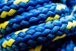 Blue and yellow rope for mountaineering sports