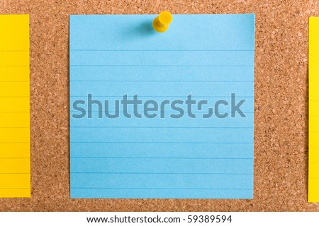 blue and yellow stripped notes attached by yellow pins on cork board - stock photo