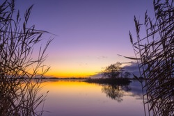 Blue and yellow Sunset over a Tranquil lake