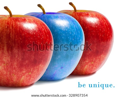 Blue apple between red ones.