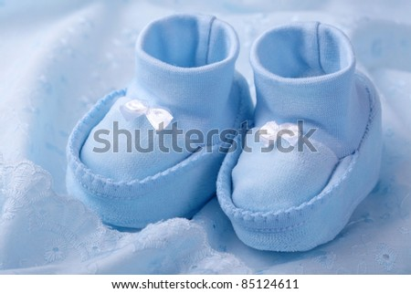 Blue baby booties on blue background