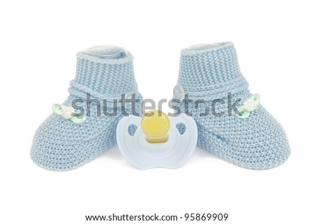 Blue baby boy shoes and dummy isolated on white background