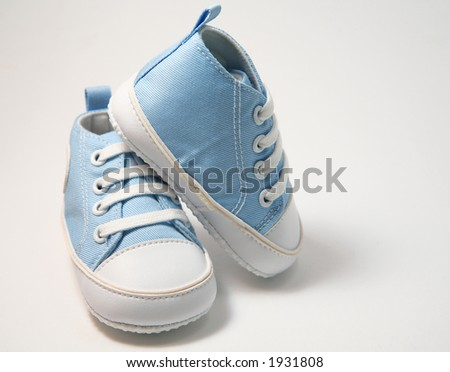 Blue baby shoes on white background