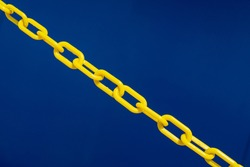 Blue background and yellow chain