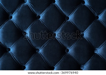 Blue background Chesterfield, fabric a velvet, for interiors and furniture