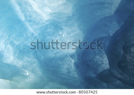 blue background created by the ice cave on the Mer de Glace glacier,  Chamonix, France