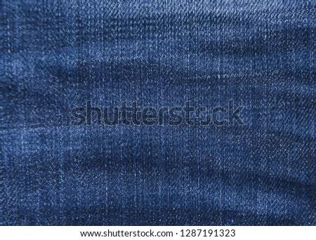 Blue background, denim jeans background. Jeans texture, denim fabric. Texture of denim or blue jeans background.