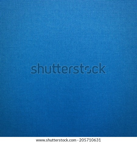Blue background from blue coarse canvas texture. Clean background.