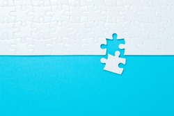 Blue background made from white puzzle pieces and place for your content