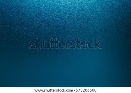 Blue background silver foil texture dark black navy abstract. Metal paper light bright backdrop design glitter christmas.
