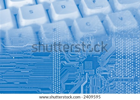 blue background with electronic circuit and keyboard