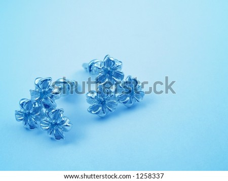 Blue background with jewelry