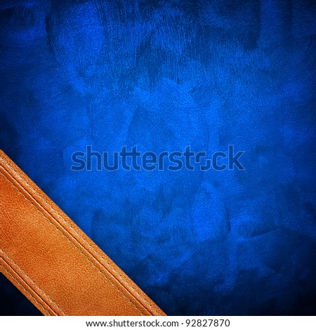 blue background with leather strip