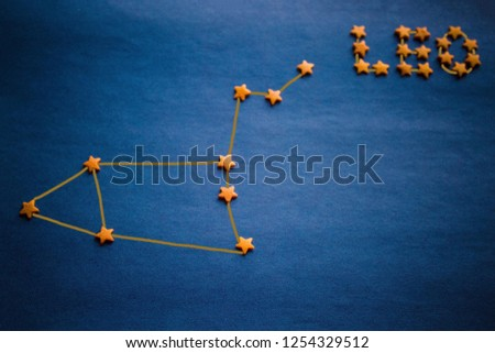 Blue background, yellow decorative stars. The location of the stars in the constellation Leo. Vignetting, copy space. The picture is made by the author.