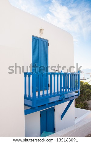 Blue balcony with blue shutters - typical of the architecture of Greece and the Mediterranean
