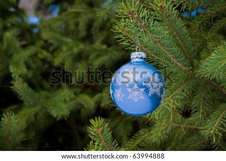 blue ball christmas ornament hanging on christmas tree