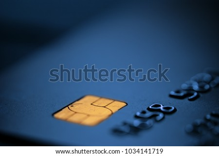 Blue bank credit or debit card with negative copy space, suitable for adding text, macro shot