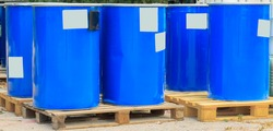 Blue barrels standing on wooden pallets on a chemical plant