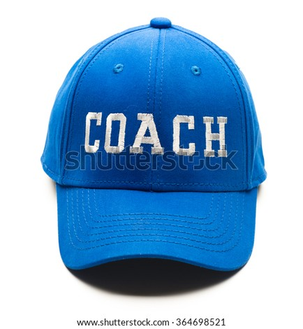 Blue baseball cap with Coach written on it isolated on white background
